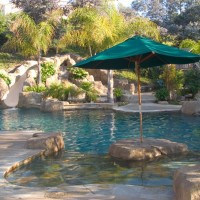 Umbrella mounted in artificial layout boulder. Tropical Paradise and fun for the whole family!
