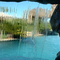 Looking out the grotto cave, the waterfall plunges down overhead. Go ahead and stand or dive through the waterfall, it's really fun!!