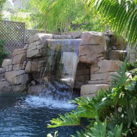 Water features are designed with rock style steps to safely climb to the top. Before you backflip into your pool.