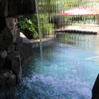Inside your cave are seat benches and a Baja landing. Dive through the cascading waterfall.