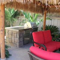 Rock textured concrete BBQ and bright furniture highlight this special place.