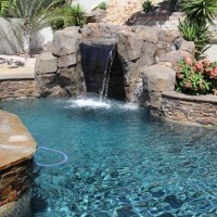 Small waterfall/grotto with Bark color stacked quartzite.