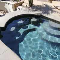 Swim –up bar stools, landing, and pool steps.