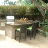 Added BBQ area with smooth finish concrete counter top and stacked quartzite planter wall