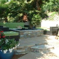 Added outdoor sitting area with stacked quartzite fire pit