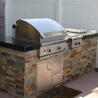 BBQ with granite counter top and quartz ledger sides.