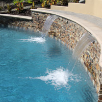 3' shear decent waterfalls on 2' raised pool wall.