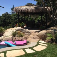 Large stone stepper lead to your raised deck and Palapa.