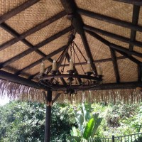 Faux Tahitian thatched palapa with chandelier.