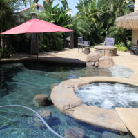 Spa with swim up bar. Large shelf area with an umbrella to relax.