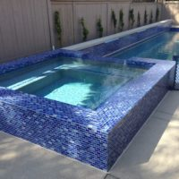 Complete overflow glass tile spa. Adds a unique sparkle to the water.