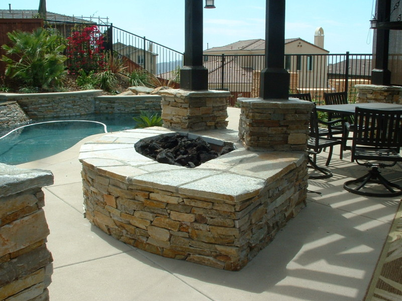 Quartz Fire Pit And Post Columns With An Open Beam Shade